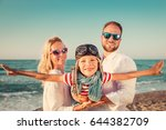 happy family on the beach.... | Shutterstock . vector #644382709