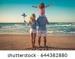 happy family on the beach.... | Shutterstock . vector #644382880