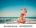 Happy Family On The Beach....