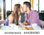couple doing breakfast in a bar ... | Shutterstock . vector #644384080