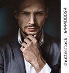 fashionable elegant man posing | Shutterstock . vector #644400034