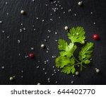 green fresh parsley on black... | Shutterstock . vector #644402770