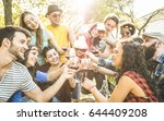 group of friends toasting red... | Shutterstock . vector #644409208