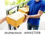 delivery man in blue uniform... | Shutterstock . vector #644427358