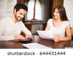 couple calculating their... | Shutterstock . vector #644431444