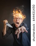 Small photo of infuriated angry senior woman slaying, holding a kitchen knife, about to kill someone
