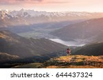 mountaineer enjoying the view... | Shutterstock . vector #644437324
