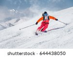 Female Skier On A Slope In The...
