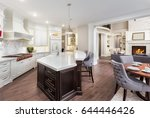Stock photo beautiful kitchen interior in stunning new luxury home with dining room and view of living room 644446426