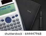calculator and pen on notebook...   Shutterstock . vector #644447968