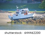 a recreational boat somehow... | Shutterstock . vector #644462200