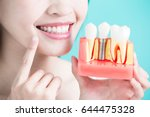 woman take tooth implant false... | Shutterstock . vector #644475328