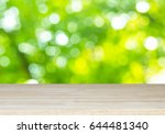 wood table on green bokeh...   Shutterstock . vector #644481340