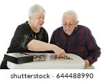 an elderly couple working on a... | Shutterstock . vector #644488990