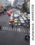 defocused scene of car in red... | Shutterstock . vector #644491558
