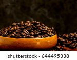 roasted coffee beans and wooden ... | Shutterstock . vector #644495338