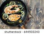 salmon steak  fried with herbs  ...   Shutterstock . vector #644503243