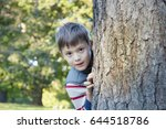 happy child playing hide and... | Shutterstock . vector #644518786