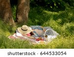 summer time. young woman is... | Shutterstock . vector #644533054