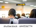 asians listen to music while... | Shutterstock . vector #644536774