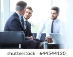 mature businessman using a... | Shutterstock . vector #644544130