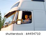 driver in the cabin of his... | Shutterstock . vector #64454710