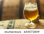 glass of light barrel aged beer ... | Shutterstock . vector #644572849