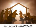 Small photo of Christmas nativity scene including Jesus,Mary,Joseph,sheep and donkey ,Brown paper cut silhouette concept.