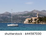 a yacht pictured off the coast... | Shutterstock . vector #644587030