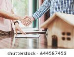 signing of a real estate... | Shutterstock . vector #644587453