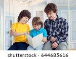 3 boy read book outdoors on... | Shutterstock . vector #644685616