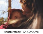 portrait of young mom hugging... | Shutterstock . vector #644690098