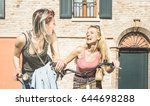 happy female friends couple... | Shutterstock . vector #644698288
