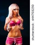 sexy woman in swimsuit posing... | Shutterstock . vector #644703250