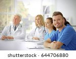 team of doctors sitting at... | Shutterstock . vector #644706880