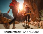 hikers with backpacks walk on... | Shutterstock . vector #644713000