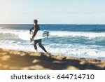 surfer man holding surfboard on ... | Shutterstock . vector #644714710