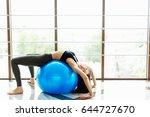 girl do exersice with ball on...   Shutterstock . vector #644727670