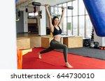 girl do her exercises with... | Shutterstock . vector #644730010