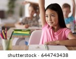 teenage student raising hand in ... | Shutterstock . vector #644743438