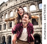 young couple at the colosseum ... | Shutterstock . vector #644754538