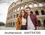 young couple at the colosseum ... | Shutterstock . vector #644754700