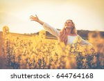 happy smiling woman in yellow... | Shutterstock . vector #644764168