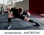 young man preparing muscles... | Shutterstock . vector #644785744