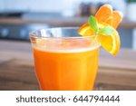 photo of carrot orange juice. | Shutterstock . vector #644794444