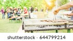man cooking bbq meat at... | Shutterstock . vector #644799214