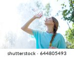young skinny girl drinking... | Shutterstock . vector #644805493