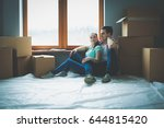 couple moving in house sitting... | Shutterstock . vector #644815420