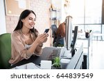 happy woman is typing on phone. ... | Shutterstock . vector #644839549