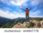 successful woman backpacker... | Shutterstock . vector #644847778